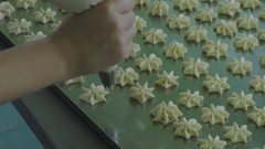 Preparation of cookies on a sheet of pastry Stock Footage