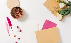 Paper box being filled with dried roses Stock Photos