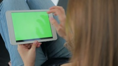 Woman using tablet computer with green screen Stock Footage