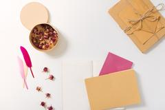 Box with dried flowers lying on the desk Stock Photos