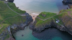 Aerial shot of the beautiful Carrick-a-Rede Rope Bridge in Ireland Stock Footage