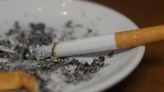 Smoking cigarette in the ashtray macro 4k Stock Footage