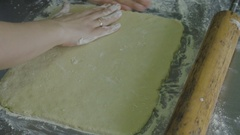 Unrolling a rolling pin dough for cookies Stock Footage