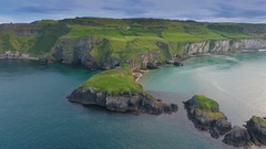 Landscape view of the Carrick-a-Rede Rope Bridge in Ireland Stock Footage