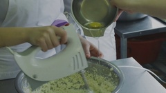 Adding eggs cookie dough Stock Footage