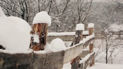 Rustic fence under the snow at winter Stock Footage