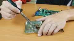 The man solders a chip Stock Footage