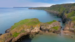 Two islands in Carrick-a-Rede Rope Bridge in Ireland Stock Footage