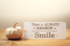 There is Always a Reason to Smile message with small pumpkin Stock Photos