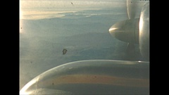Vintage 16mm film, 1954, inflight passenger plane propeller and landing Stock Footage