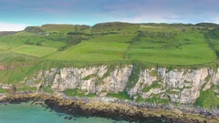 The big mainland in Carrick-a-Rede Rope Bridge in Ireland Stock Footage
