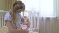 Mom cradles the baby on her hands. Stock Footage