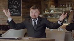 Male businessman rejoices success Stock Footage