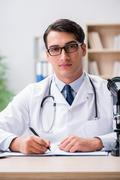 Young adult doctor working in the hospital Stock Photos