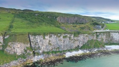 The cliff and the shore in Carrick-a-Rede in Ireland Stock Footage