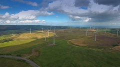 Landscape aerial view of the big windmills in Ireland Stock Footage