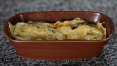 Al forno pancake with chicken and mushrooms in bowl Stock Footage