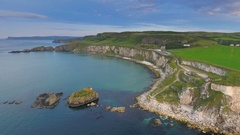 The view of the small islands on the sea in Carrick-a-Rede in Ireland Stock Footage