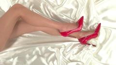 Woman's legs lying on cloth. Stock Footage