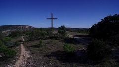 Drone shot flying past cross on Cross Mountain, Fredricksburg Texas Stock Footage