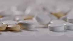 4K Health care concept of mixture of medications with rolling empty pill bottle Stock Footage