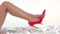 Bare legs wearing red heels. Stock Footage
