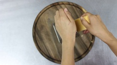 Women hand grating the cheese with a metal grater. top view Stock Footage