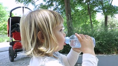 Baby sitting drinking and smiling Stock Footage