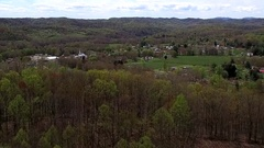 Aerial Footage of Remote Small Town in Green Hill Background Stock Footage