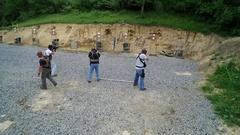 Crane Shot of shooters at firing range.  Stock Footage