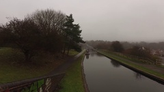 Fast smooth tracking shot along a dull gloomy Birmingham canal. Stock Footage