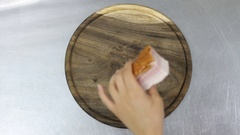 Chef cuts ham on a wooden board. top view Stock Footage