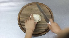 Chef cuts boiled chicken fillet on a wooden board. top view Stock Footage