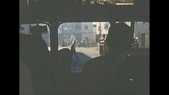 Vintage 16mm film, 1954 Spain, small town bus ride POV, narrow streets Stock Footage