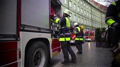Firefighter putting equipment into firetruck, dangerous job, responsibilities Stock Footage