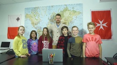 A group of schoolkids the teacher show the finger to the top Stock Footage