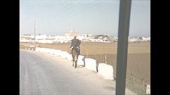 Vintage 16mm film, 1954 Gibralter b-roll busride POV, steam train passes Stock Footage