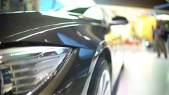 Close-up of headlights, luxury automobile standing at shopping center, trade Stock Footage