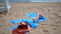 Pregnant woman lying on sea beach. Top view of beautiful woman relax on beach Stock Footage