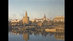 Vintage 16mm film, 1954 Spain Seville Telmo bridge people, vendors, sunset Stock Footage