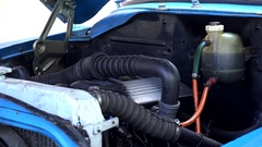 Redesigned engine under the open hood of an old american car. Havana, Cuba Stock Footage
