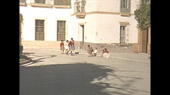 Vintage 16mm film, 1954 Spain Seville children playing in courtyard Stock Footage