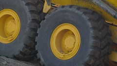 The big black tires of the excavator in the site in Ireland Stock Footage