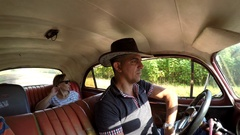 Ride in the old American car (taxi). Cabin view with the driver & passenger. Stock Footage