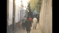 Vintage 16mm film, 1954 Spain Seville narrow streets and shops Stock Footage