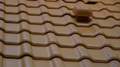 Red roof tiles that is new and shiney in Ireland Stock Footage