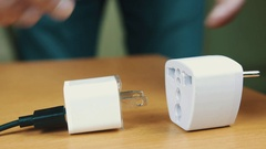 The man connects USB power supply unit to an adapter. Stock Footage