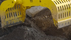 A yellow grapple about to get soil on the site in Ireland Stock Footage