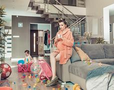 Young pregnant mom and her little daughter at home Stock Photos