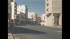 Vintage 16mm film, Morroco Tangiers streetlife modern buildings, traffic... Stock Footage